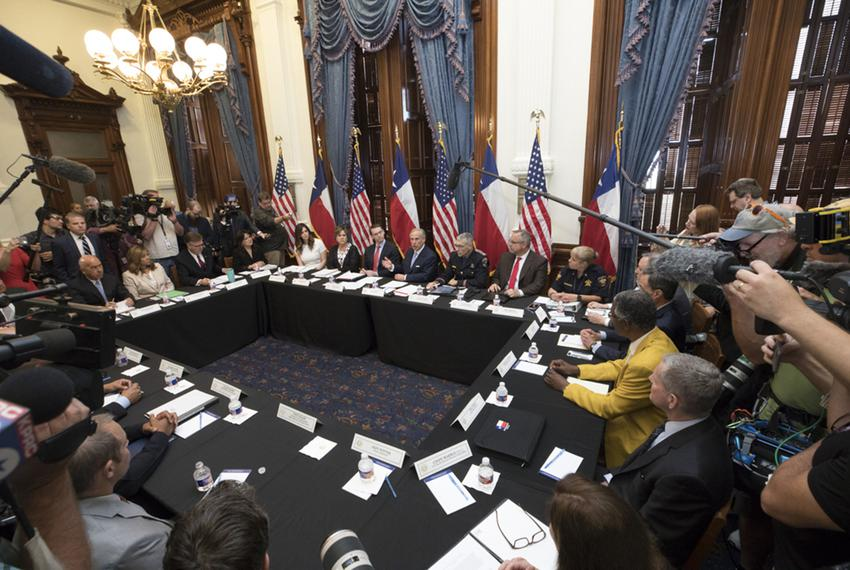 Gov. Greg Abbott (top center, in front of U.S. flag) held the first of three roundtable discussions on school safety in Au...