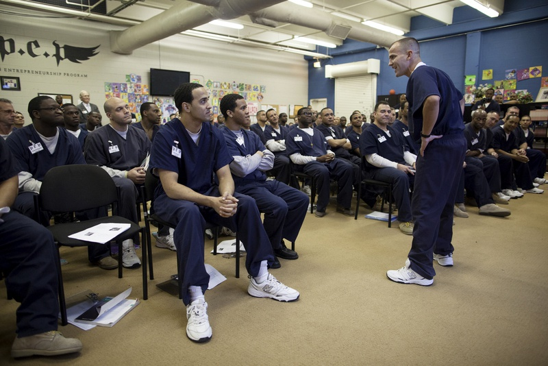 Morgan Crocker delivers a business proposal for a fitness training service during the weekly session of the Prison Entrepreneurship Program at the Cleveland Correctional Center in Cleveland, Texas.