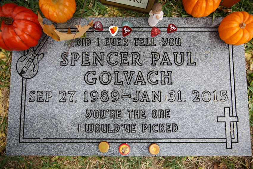 The grave of Spencer Golvach, has beer caps and guitar picks left by friends, in Houston Tuesday, October 20, 2015.