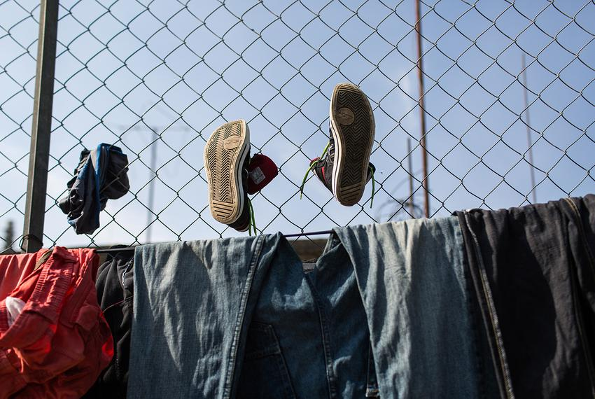 Clothes and shoes hung up to dry in Albergue Para Migrantes Chahuites migrant shelter in Chahuites, Mexico, on April 25, 201…