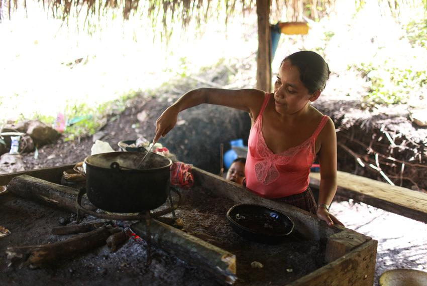 Byron's mother, Florinda Bol, cooks at her home in San Miguel Limón, where she lives with her husband David and two of her t…