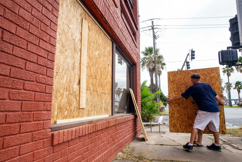A Galveston resident boards up a home on Broadway Street, hours before Hurricane Laura is set to make landfall. Aug 26, 2020.