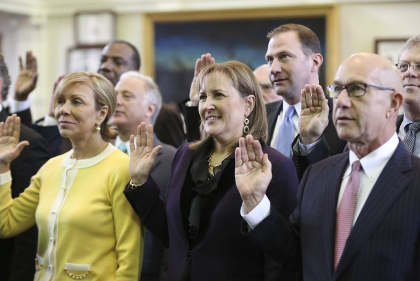 New Texas Sen. Konni Burton, c, stands with other incoming Senators during the swearing-in ceremony at the Texas Capitol Jan. 13, 2015.