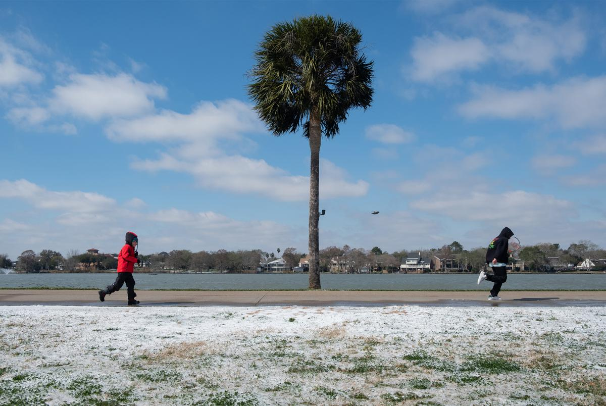 A handful of people visited the park with tennis rackets in hand on Feb. 15, 2021 in Houston. A rare snow blanketed the city as well as other parts of Texas.