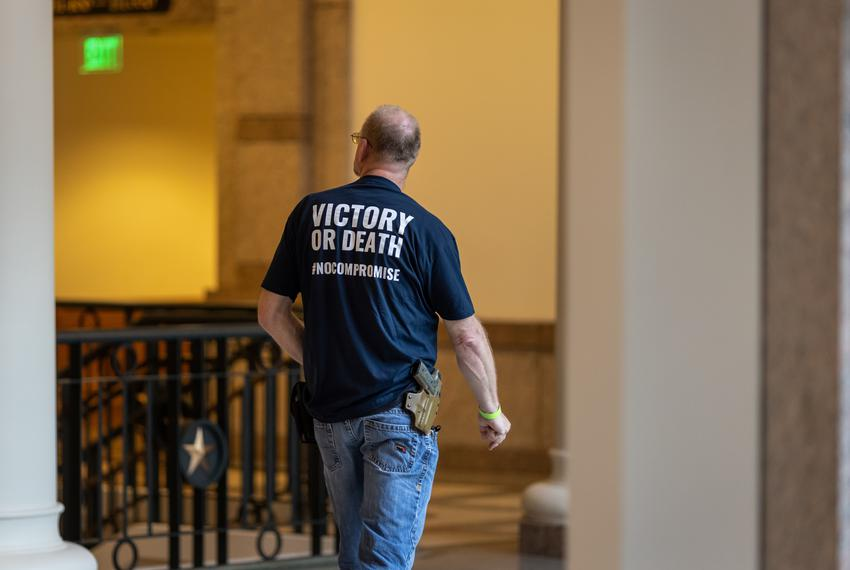 A man with a holstered handgun at the Texas Capitol on April 29, 2021.
