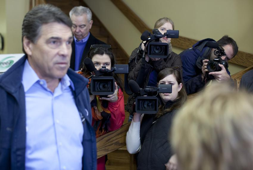 Gov. Rick Perry speaking to a resident of Greer, S.C., during a downtown walk on Jan. 18, 2012.