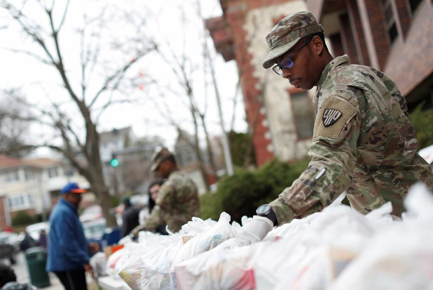 National guard troops help with Food distribution during the coronavirus outbreak in New Rochelle, New York on March 12, 202…