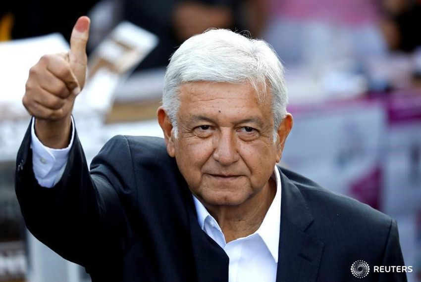 The leftist presidential candidate Andres Manuel Lopez Obrador greets supporters after voting in Mexico City.