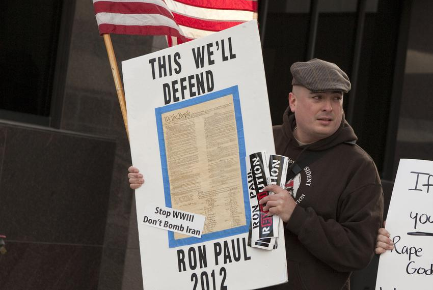 Ron Paul supporters gather outside a building in downtown Austin on Feb. 24, 2012, expecting to see GOP presidential hopef...