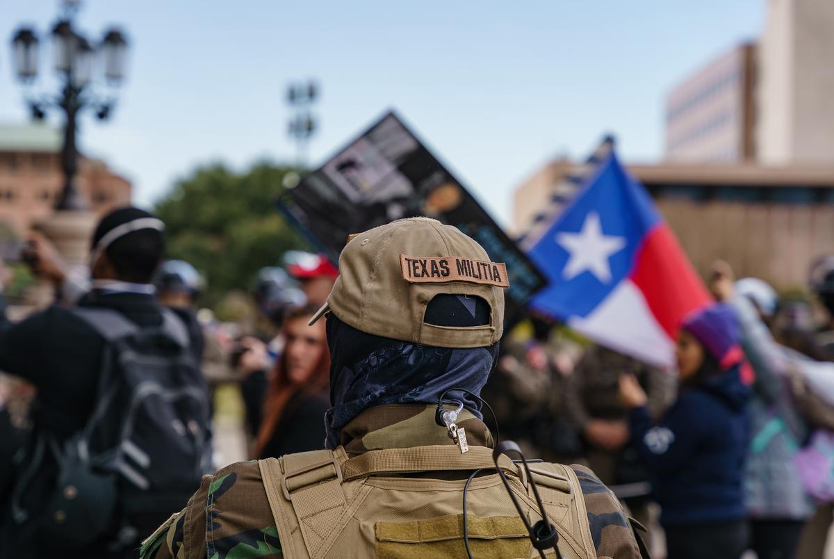 A group of armed protesters gathered for a  demonstration at the Capitol's north entrance on Jan. 12, 2021.