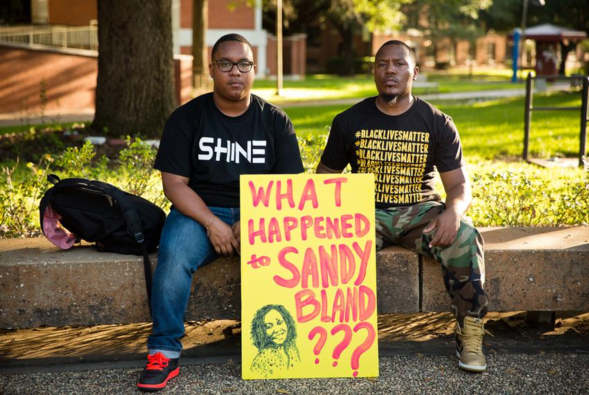 Former Prairie View A&M students Rhys Caraway and Harrison Guy wait for the Sandra Bland vigil to start.