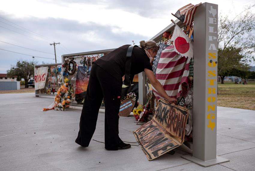 Nubia Legarda, visits a memorial honoring the victims of the Walmart shooting at Ponder Park in El Paso.