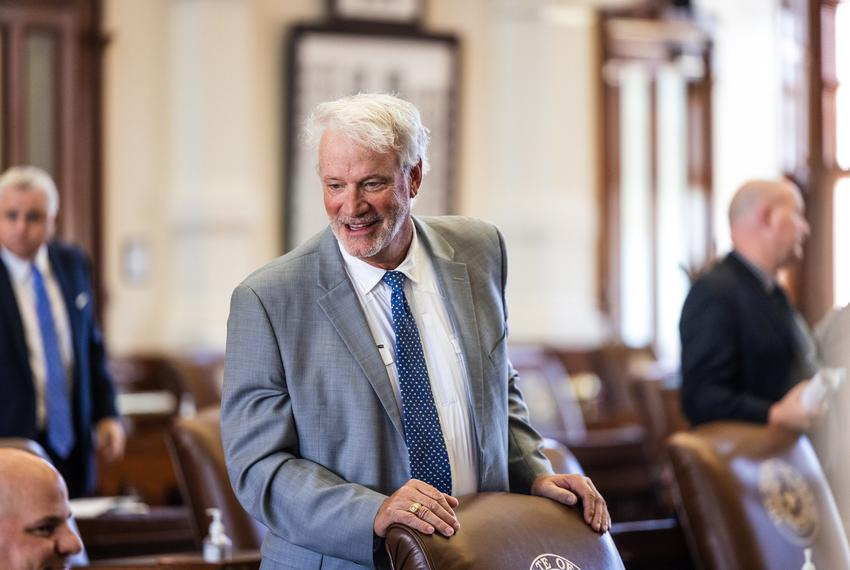 State Rep. Lyle Larson, R-San Antonio, speaks with colleagues on the House floor on Tuesday, August 10, 2021.