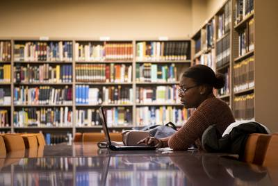 Paul Quinn College senior Chaze Sanders studies at the library on Nov. 11, 2019.