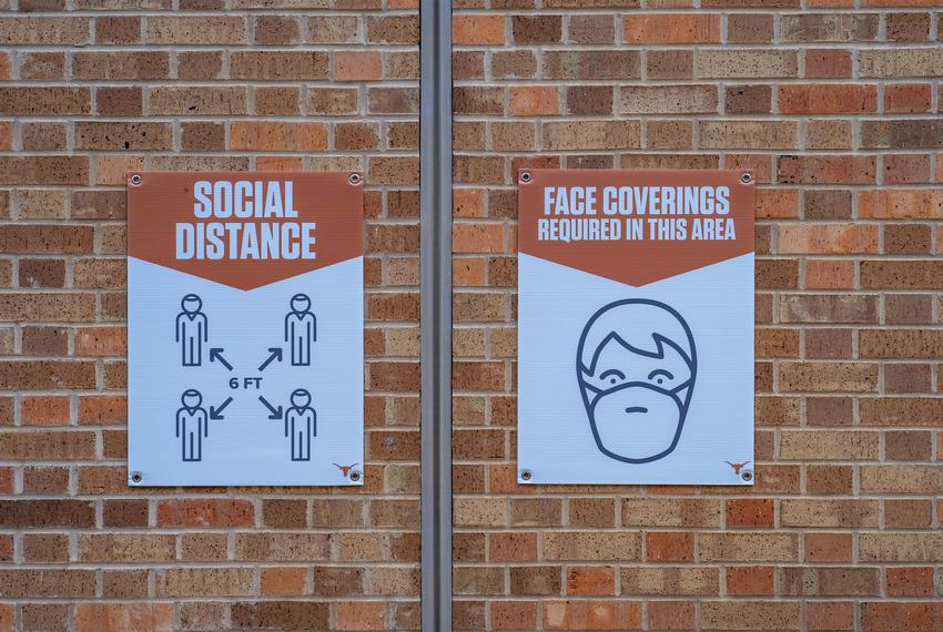 Signs encouraging mask wearing and social distancing were posted around the stadium.