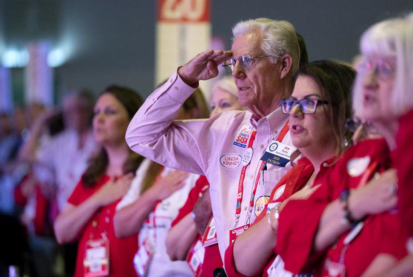 The Texas Republican Convention at the Henry B. Gonzales Convention Center in San Antonio. Bob Parks salutes the flag from t…
