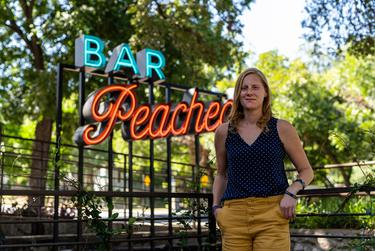 Ashleigh Roessler outside Bar Peached in downtown Austin where she works as a server on Aug. 13, 2020