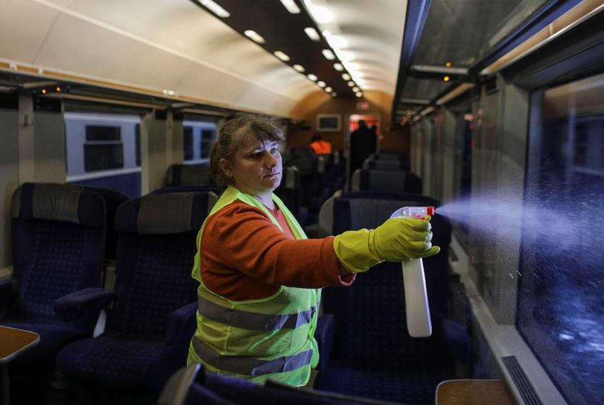 Cleaning staff uses disinfectants to clean a train of the Romanian Railway Service, in Bucharest, Romania on February 26, 20…