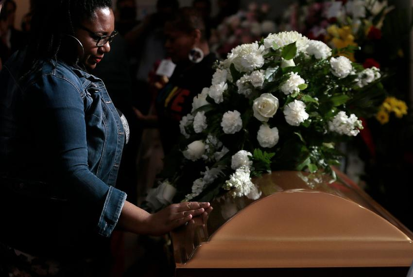 Lon Shae places her hand on Margie Reckard        s casket during her funeral at La Paz Faith Center in El Paso, Texas Frida…