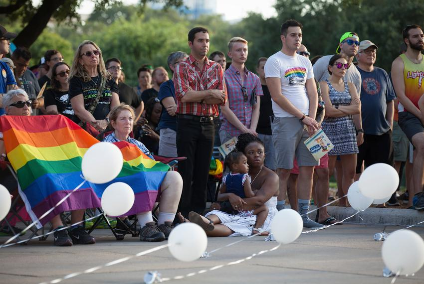 Activists and members of Austin's LGBT community gathered on the steps of the capitol to celebrate the anniversary of the 19…