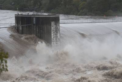 Floodwaters surge in the Colorado River and continue downstream from Marble Falls to Lake Travis and the Mansfield Dam.