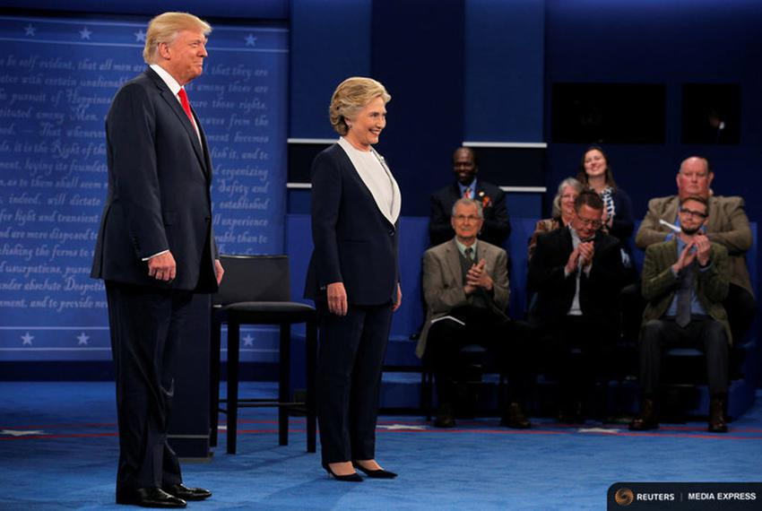 U.S. Republican presidential nominee Donald Trump and U.S. Democratic presidential nominee Hillary Clinton take the stage at…
