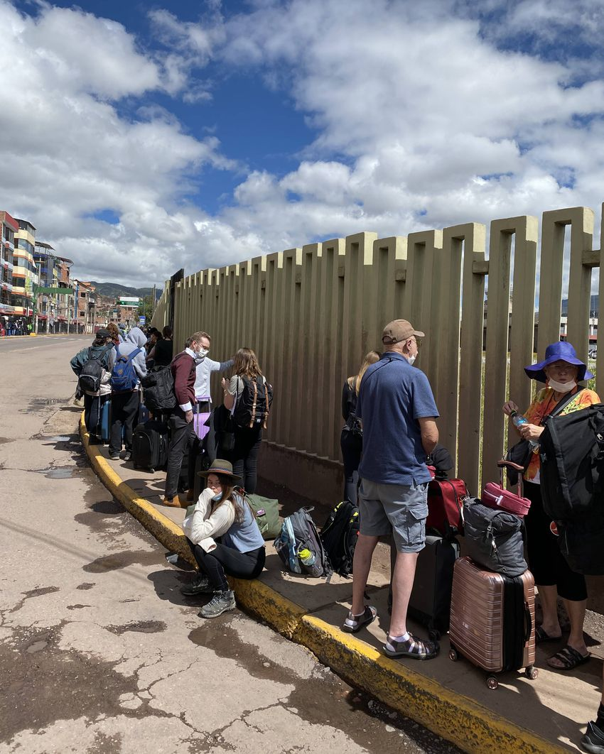 Passengers wait outside the Cusco airport for an evacuation flight to Miami.