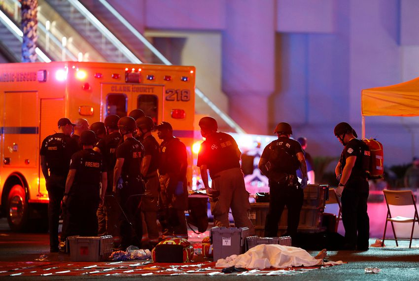 A body is covered with a sheet in the intersection of Tropicana Avenue and Las Vegas Boulevard South after a mass shooting at a music festival on the Las Vegas Strip in Las Vegas, Nevada on October 1, 2017.