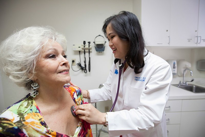 Physician Christine Le, an osteopathy specialist at the Kelsey-Seybold Clinic in Houston, checks up on her patients Mary Ann Goolsby and her husband Joseph Goolsby, Tuesday June 10, 2014.