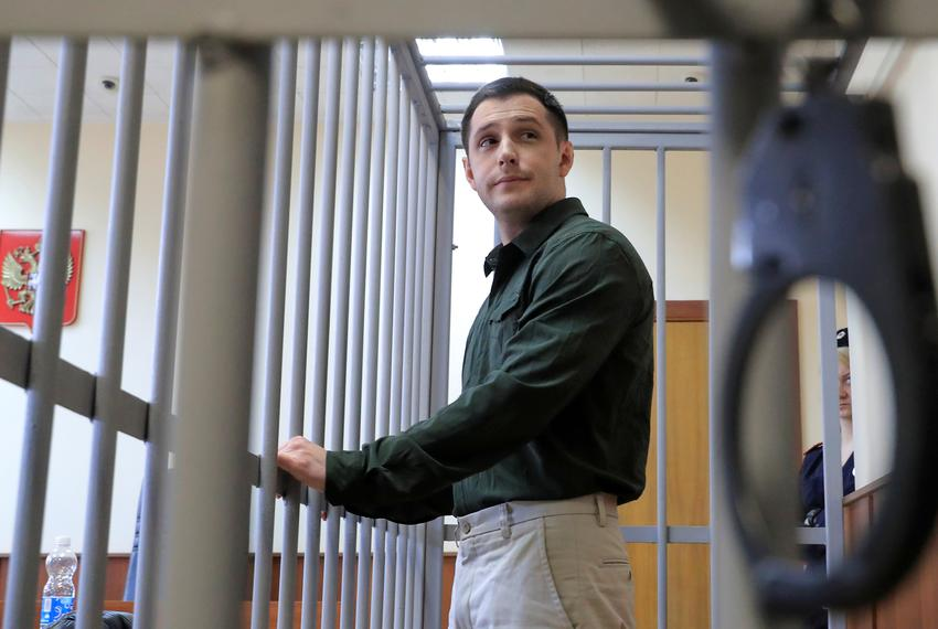 U.S. ex-Marine Trevor Reed, who was detained in 2019 and accused of assaulting police officers, at a court hearing in Moscow…