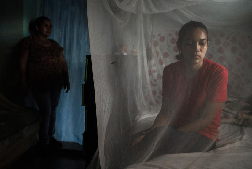 Claudia, right, and her mother, Suyapa, left, in their home in Olancho, Honduras.