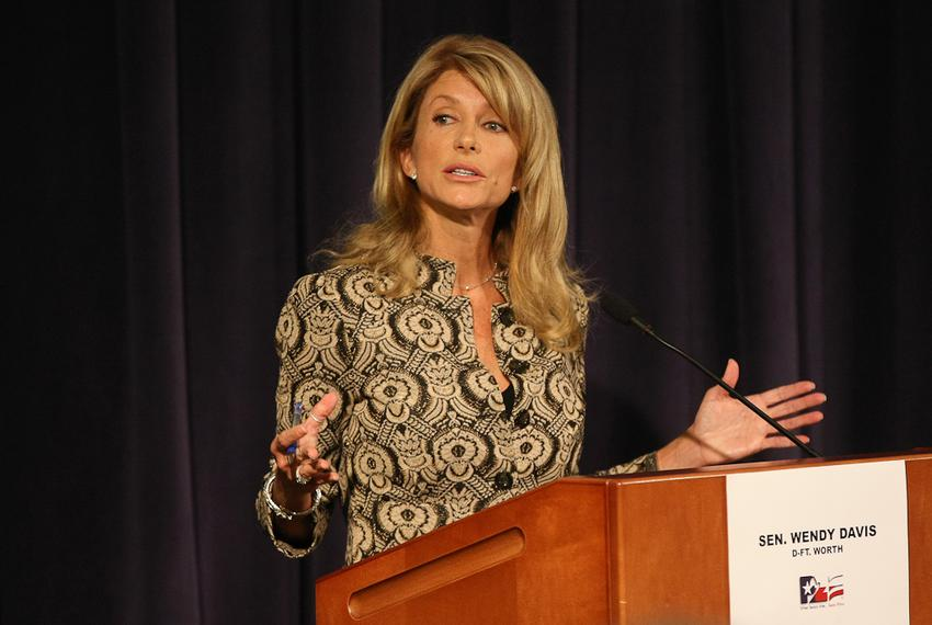 State Sen. Wendy Davis squaring off against Republican Mark Shelton at a debate at the Tarrant County College Trinity River …