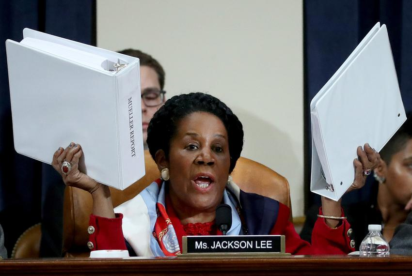 U.S. Representative Sheila Jackson Lee, D-Texas, holds up copies of the Mueller Report as she questions constitutional schol…