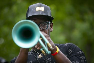New Orleans musician Dave Washington plays Amazing Grace outside the George Floyd public memorial service.