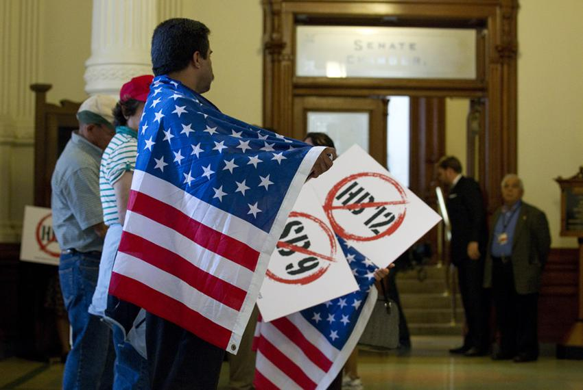 """Protesters with American flags line the hallway outside the Senate chamber protesting HB12 the so-called """"sanctuary cities"""" …"""