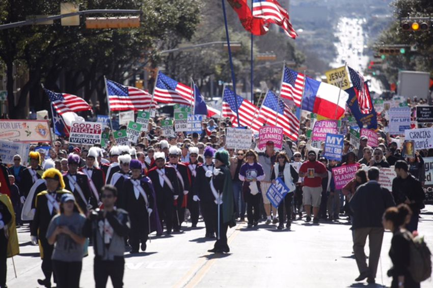 Anti-abortion demonstrators march up Congress Avenue toward the Capitol in Austin for the Texas Rally for Life on Jan. 28, 2017.