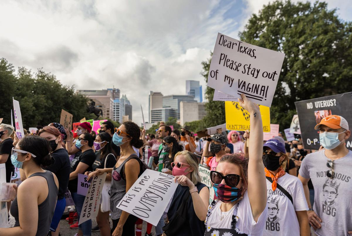 Fifi Theriot protests at the Women's March in Austin on Oct. 2, 2021.