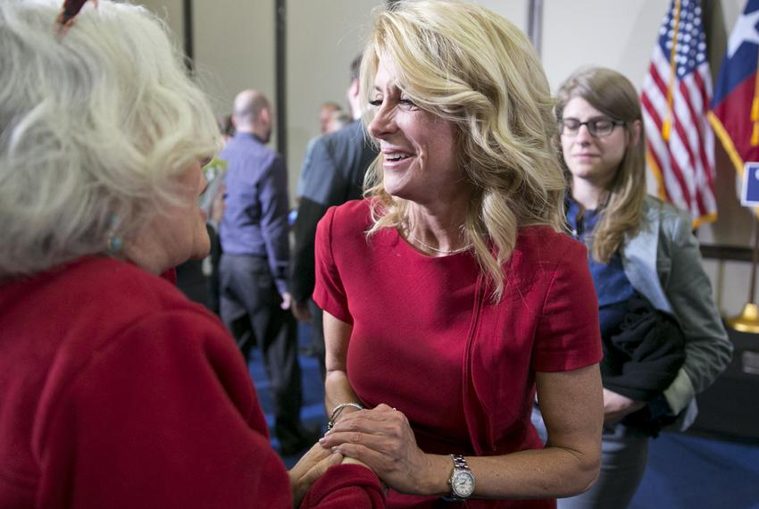 Texas Senator and Gubernatorial candidate, Wendy Davis greets a supporter following an education rally in Austin on April 14…