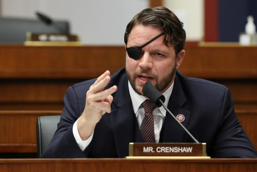 U.S. Rep. Dan Crenshaw, R-Houston, questions witnesses during a House Homeland Security Committee hearing on Capitol Hill in…