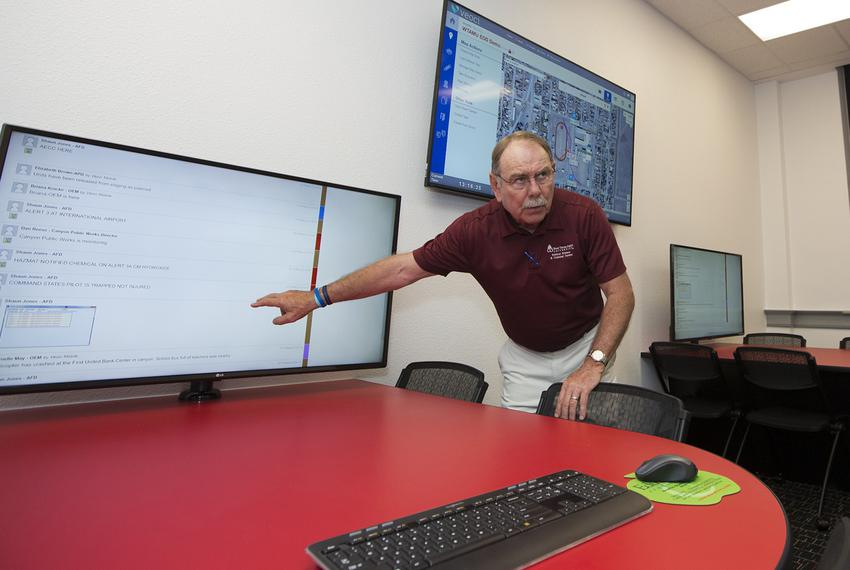 Harry Hueston, professor of Criminal Justice at West Texas A&M University, demonstrates emergency operations software inside a classroom on campus in Canyon on June 15