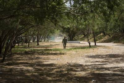 A Mexican soldier patrols an area near the banks of the Rio Grande in Matamoros, Tamaulipas.