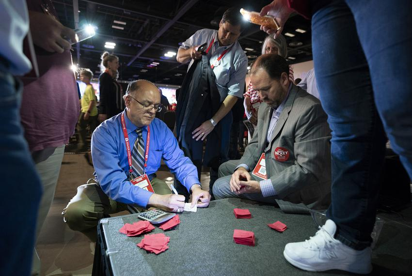 Party officials count ballots for the chairman's race between incumbent James Dickey and challenger Cindy Asche at the Repub…