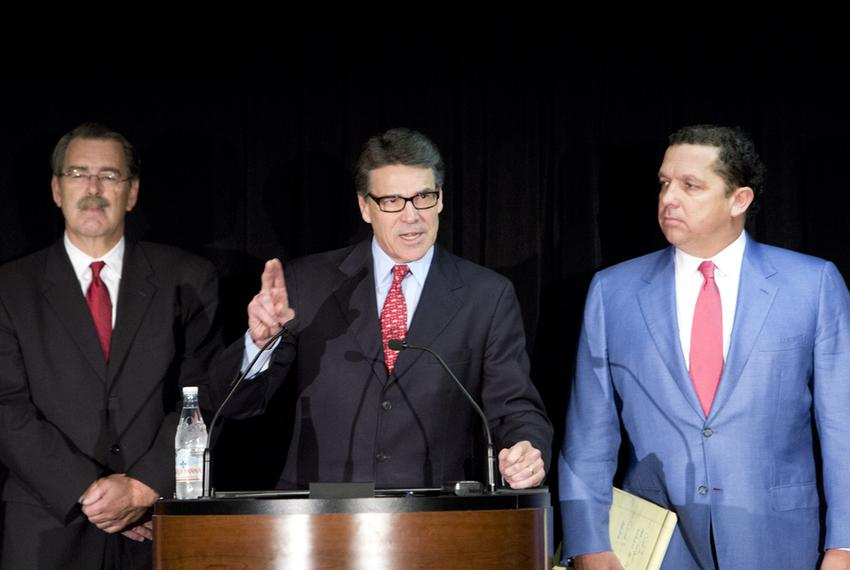 Former Gov. Rick Perry during a Jan. 28, 2015, press conference with his lawyers, Tony Buzbee and David Botsford.