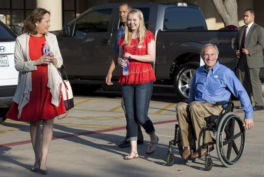 GOP gubernatorial candidate Greg Abbott, with wife Cecilia and daughter Audrey, leaves a south Austin polling place after vo…