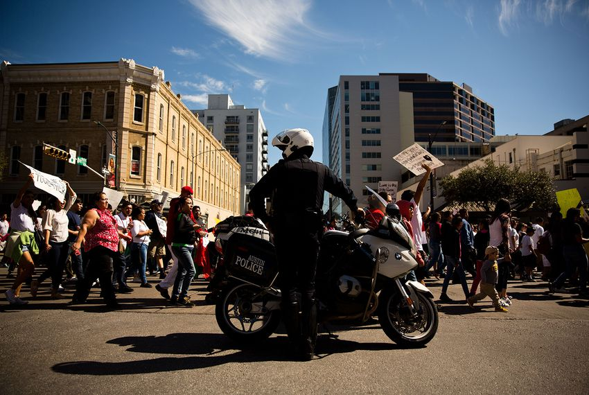 "Austin Police Department set up rolling roadblocks downtown for the ""Day Without Immigrants"" march on Feb. 16, 2017."