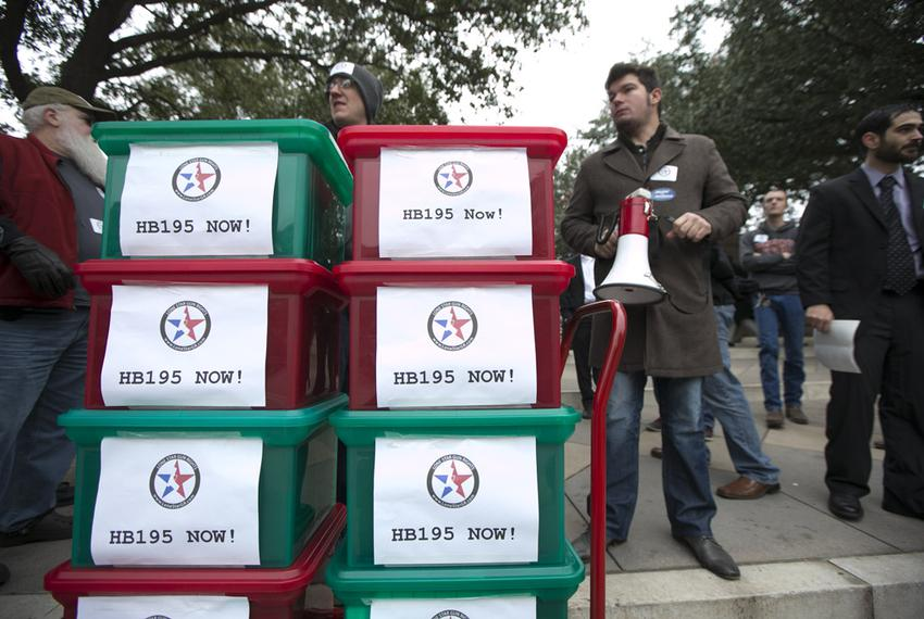Justin Delosh, r, of Lone Star Gun Rights stands with petitions to be delivered to legislators on the first day of the Texas…
