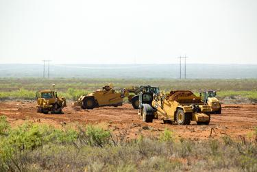 Public land near Carlsbad, N.M., is cleared for oil and gas development on May 24, 2018. Wayne Smith, who leased it for ranching before his death in October, said he never received notification of the construction there.