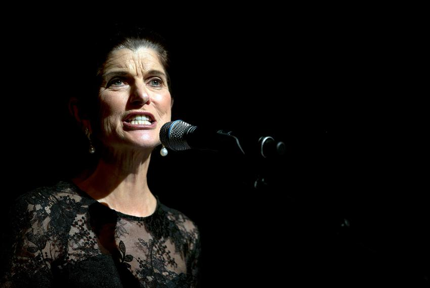 Luci Baines Johnson, daughter of former President Lyndon Johnson, gives a reading prior to a speech by former President Bill…