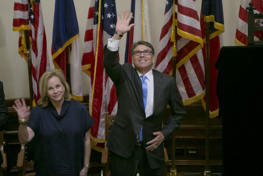 Gov. Rick Perry, waves to the crowd during the unveiling ceremony of his official portrait inside the Capitol rotunda on May 6th, 2016