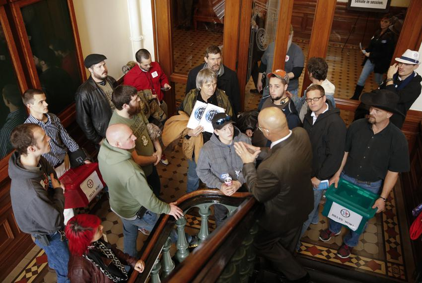 Senate Sergeant at Arms Rick DeLeon tells a group from Lone Star Gun Rights that they are not allowed in the secure back h...